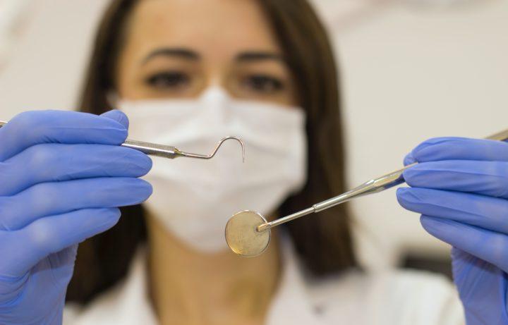How do dentists remove tartar?